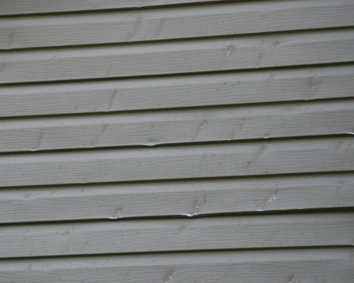 5 worst mistakes of historic homeowners part 3 siding for Hail damage vinyl siding